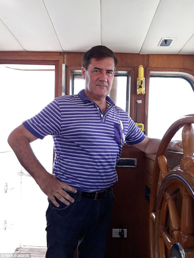 herve jaubert photographed standing at the wheel of a yacht while at sea